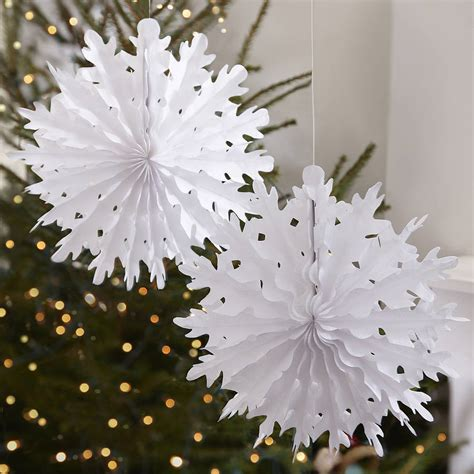 christmas decorations with tissue paper two pack snowflake tissue paper decorations by notonthehighstreet
