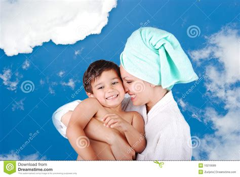 mom and son in bathroom young mother and her son after taking a bath royalty free