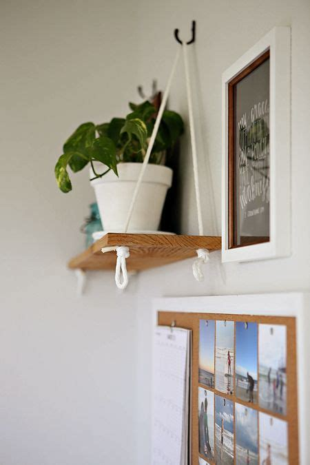 1000 ideas about hanging bookshelves on
