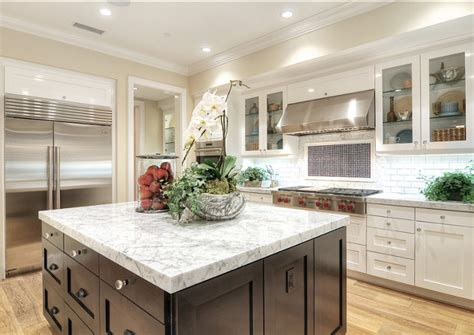 black countertops and white cabinets transitional family home with coastal transitional interiors home