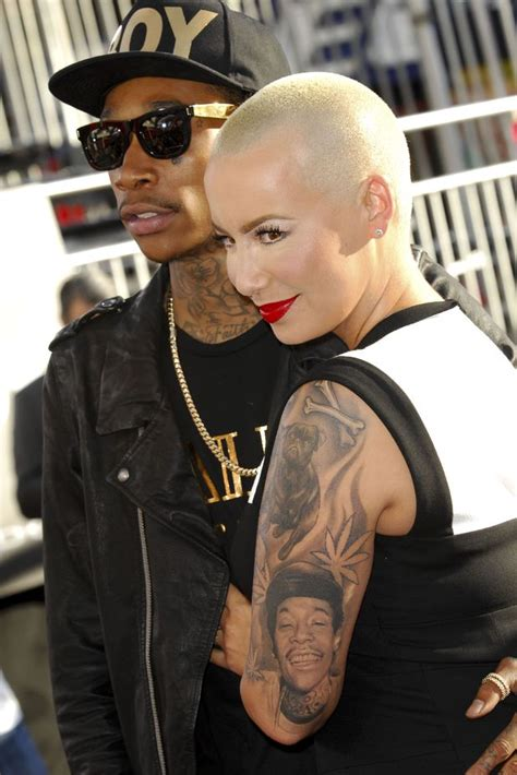 amber rose leg tattoo wiz khalifa and with portrait tattoos