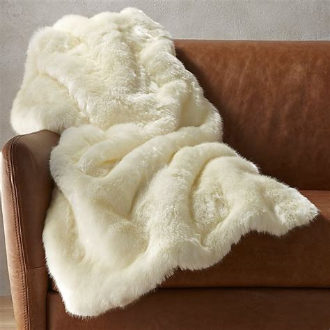 how to put a throw blanket on a sofa white faux fur throw blanket cb2