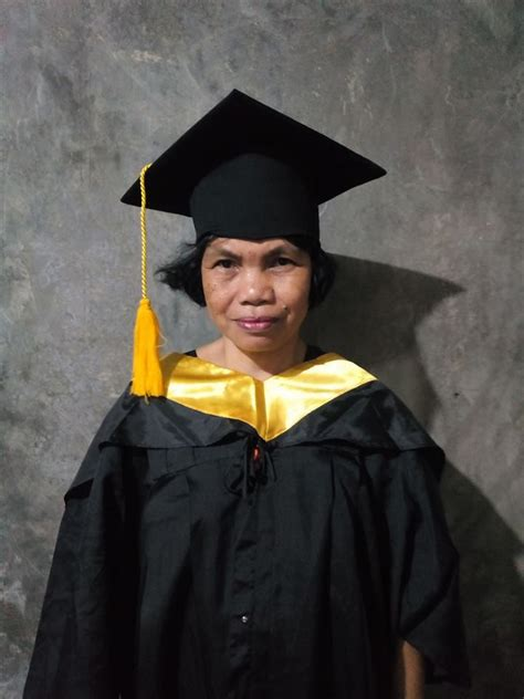 pinay mom dons  sons graduation cap gown