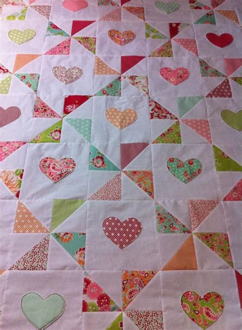 hearts and pinwheels quilt top made with moda scrumptious