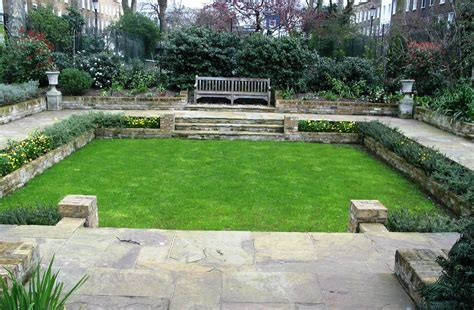 landscaping backyard sunken garden with reclaimed yorkstone and lawn simon scott landscaping