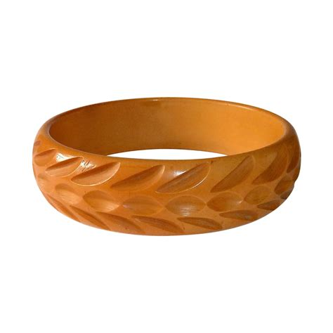 butterscotch bakelite carved bangle bracelet from