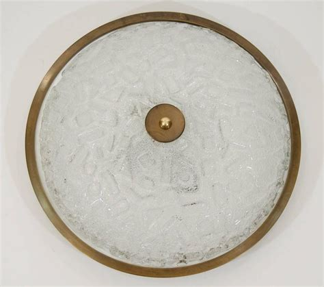large deco style flush mount with antique brass