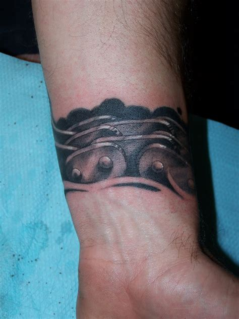 artistic ink motorcycle chain tattoo
