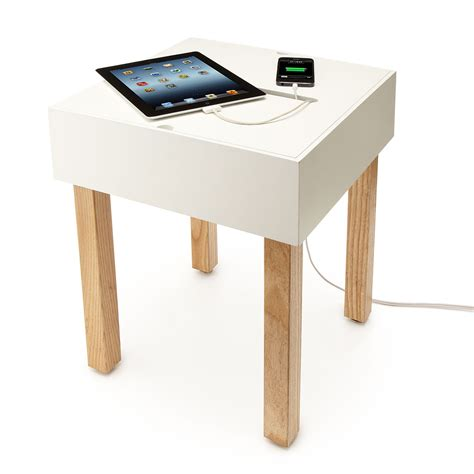 table chargers organize all of those charger cords with the hub table