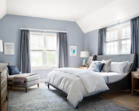 Large transitional guest bedroom photo in new york with blue walls and