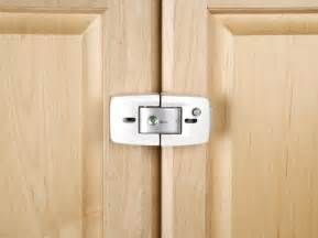 kitchen cabinet door latches kitchen cabinet locks neiltortorella com