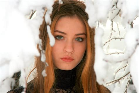 girl with brown hair in snow brown hair green eyed brown hairs