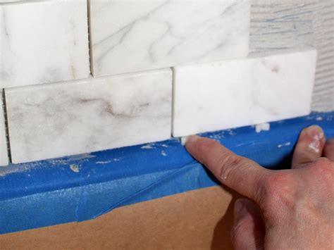 how to caulk a sink backsplash how to install a marble tile backsplash hgtv