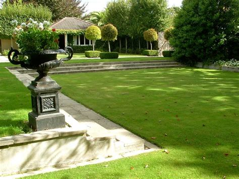 define backyard a lovely sunken lawn area with wide shallow steps can