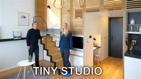 tiny studio apartment sleeping loft  moving staircase