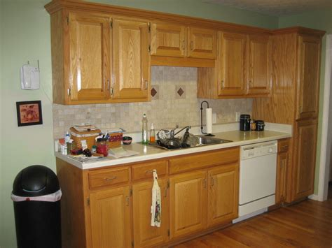backsplash ideas for oak cabinets natural oak wood kitchen cabinet with white porcelain