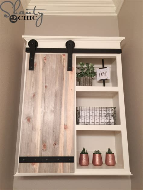 sliding bathroom barn door diy sliding barn door bathroom cabinet shanty 2 chic