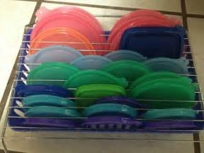 Top Basket Organize Pesky Food Storage Lids diy home sweet home 50 insanely clever organizing ideas