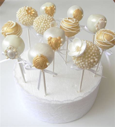 decorating cake pops for bridal shower vintage lace brooches and pearls themed wedding pops created by just call me martha https