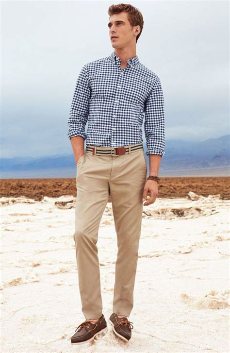 boat shoes with khakis navy and white long sleeve shirt khaki chinos dark brown