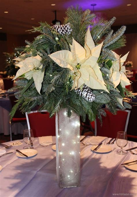 corporate holiday party frozen white  blue winter theme tall christmas table centerpiece