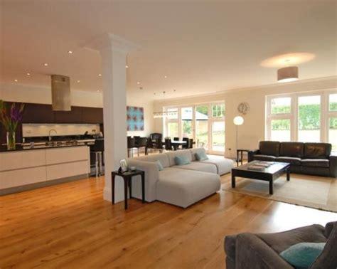 photo of open plan beige orange kitchen kitchen diner