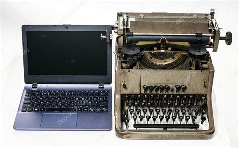 vs computer new laptop computer vs vintage typewriter stock