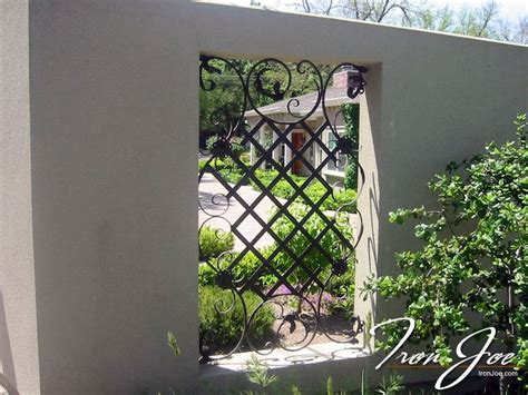 ornamental iron fence accent  stucco property fence