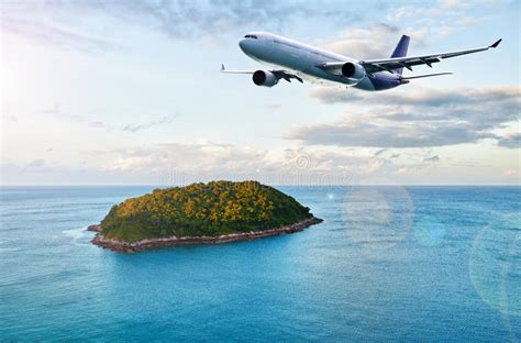 passenger plane  tropical island royalty  stock