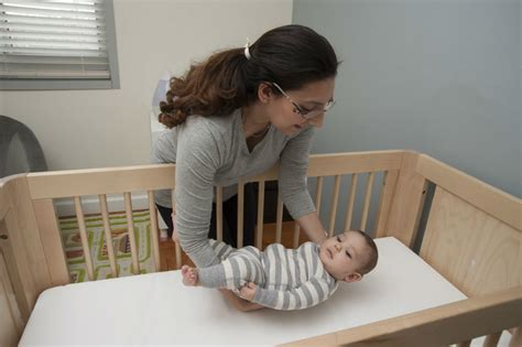 Putting Baby To Sleep In Crib Crib Ads Often Depict Unsafe Sleep Practices Study Finds