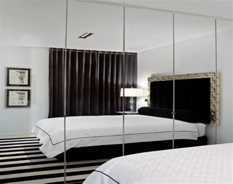 bedroom with mirror wall wall mirror design indoor wall water features water wall design interior designs