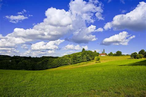 wallpaper field clouds hill grass desktop wallpaper