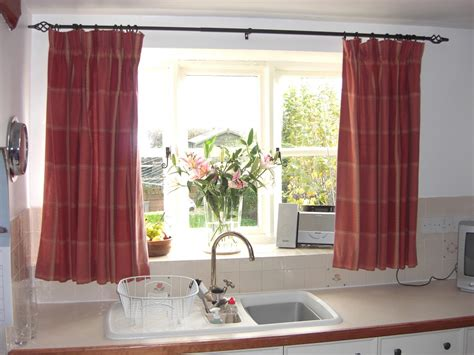 Kitchen curtains in a warm color