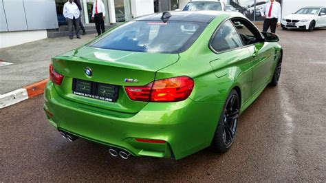 green bmw m4 java green bmw m4 touches down in south africa