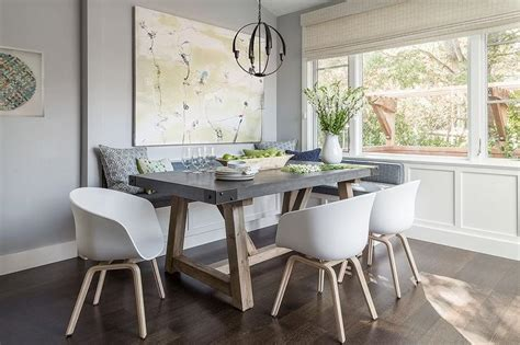 gray dining nook with salvaged wood and concrete dining