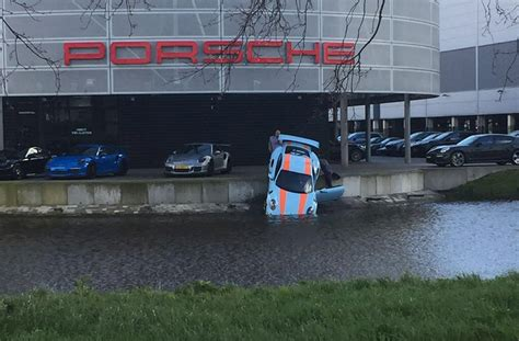 porsche dealership inside porsche dealership puts 911 gt3 rs into the drink