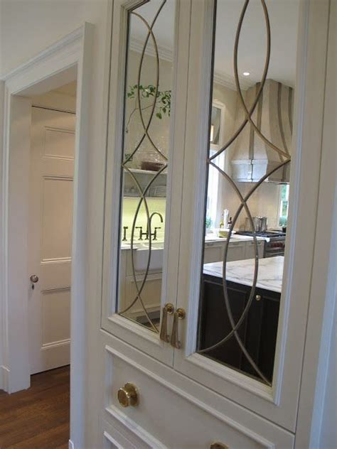 mirrored kitchen cabinet doors mirror on kitchen cupboard doors design indulgence the