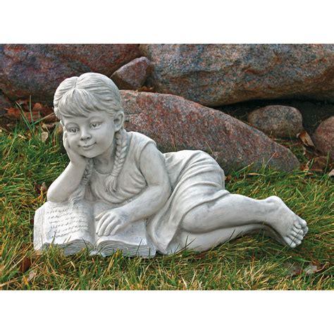 little girl sitting on bench statue little girl book lover sculpture child reading garden