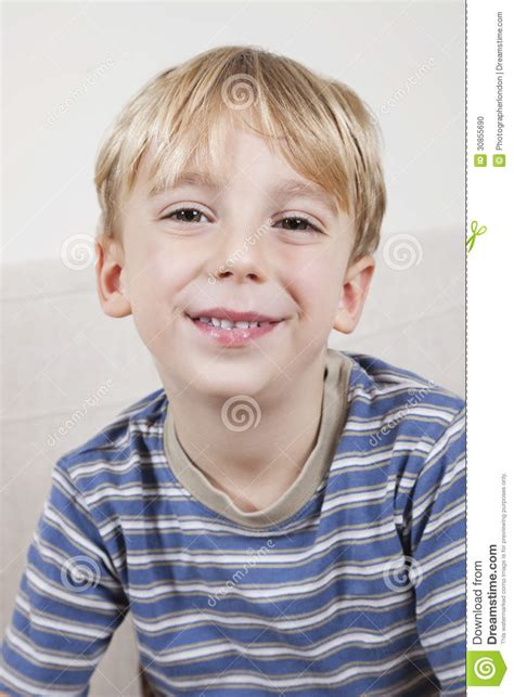 close up portrait of cute young boy stock image image close up portrait of cute young boy smiling stock photo