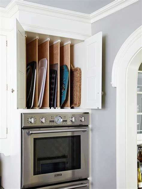 vertical tray dividers kitchen cabinets baking pan storage in traditional kitchen