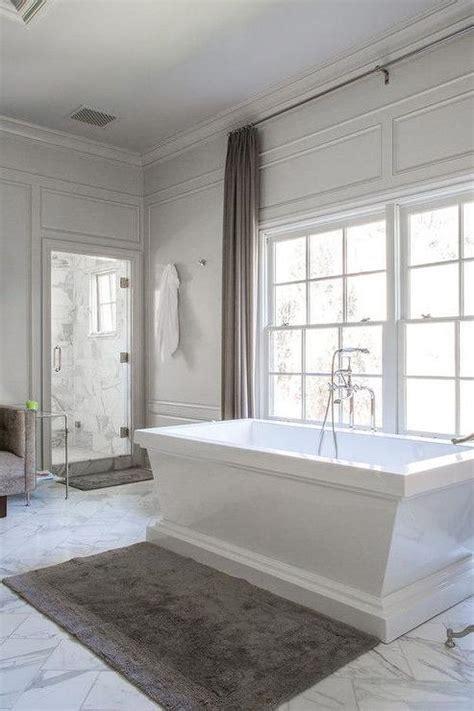 bathroom wall trim spa bathtub with white marble diamond pattern tile floor