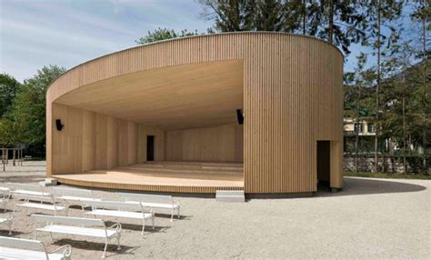 timber architecture elliptical music pavilion in austria is made from locally
