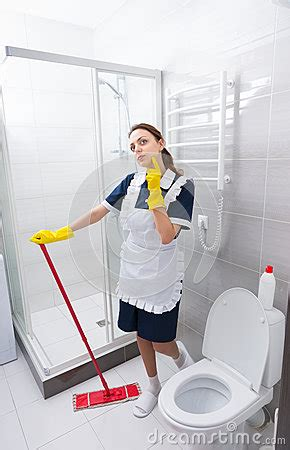 maid in bathroom pretty young housekeeper or maid stock photo image 69400834