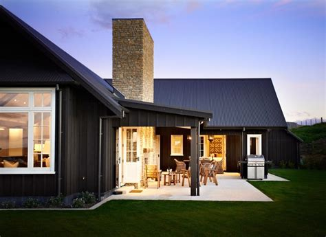 black siding houses black board batten siding with a frame roof architecture and interiors pinterest