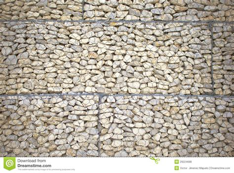 stone wall with wire mesh for background stock photo