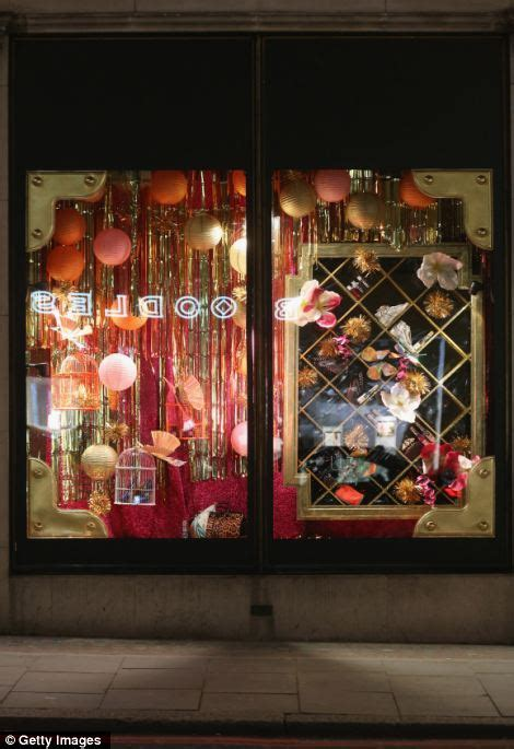 christmas window stores a flying carpet and a gingerbread house quot s department stores show their
