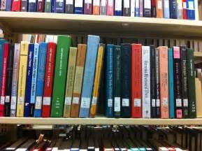 file language and rhetorics books on library shelf jpg