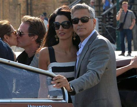 George Clooney Kisses For The Right Price by George Clooney And Fiancee Amal With