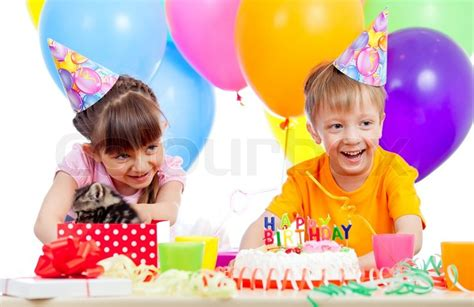 happy children celebrating birthday party with opening