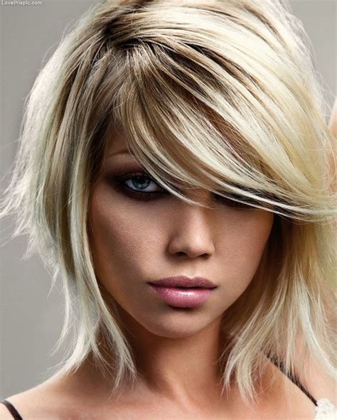 mid length layered hairstyle with box layers and curls hair medium length layered pictures photos and images